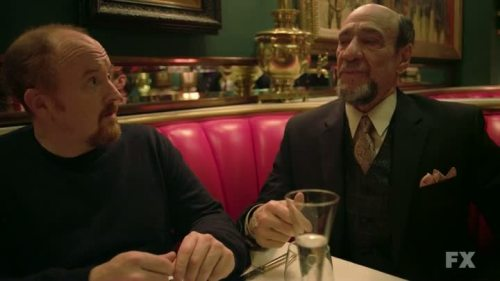 "Louie, Ep. 3.08: ""Dad"" the show's most brazenly cinematic outing yet Louie, Season 3, Episode 8: ""Dad"" Written by Louis CK Directed by Louis CK Airs Thursdays at 10:30pm ET on FX After last week's mostly ""off"" outing, Louie comes back swinging with one of its most brazenly cinematic episodes, a 22-minute whip-pan through a wide variety of topics and moods that feels very much like a dry run for CK's theoretical return to feature-length filmmaking. (CK has stated that he's considering running a Kickstarter-esque campaign to raise the funds to independently produce another movie, hoping to dodge the stdio interference that he feels doomed his surreal comedy Pootie Tang.) ""Dad"" ostensibly follows a single plot thread for its entire duration, but it does so through a series of otherwise disconnected vignettes, all of which work, which is a relief after the draggy last two thirds of ""IKEA/Piano Lesson."" ""Dad"" also opts out of the traditional Louie opening, instead treating us to the sight of CK's screen daughter Ursula Parker and her considerable violin playing – rudely interrupted by her dad, who is adamant that this is homework time. ""But it's beeyooteeful!"" Tough luck, kid. The scene gives us a rare glimpse of Louie as a less-than-ideal parent, which is fitting given that Louie spends the rest of the episode literally sick from the thought of even seeing his own father. But before that fateful almost-meeting, Louie faces a marathon of ramping unpleasantries, from an embarrassing ""assault"" at a Best Buy-esque electronics store (and a hilarious instant-replay via security camera, starring a schlubbier stand-in), to a bizarre meeting with his deeply eccentric ""Uncle Ex"" (F. Murray Abraham, making his second Louie appearance), to a poker game that gets rudely interrupted by Louie's mysteriously upset stomach. (The scene is just the latest bit of Louie's increasing acknowledgement of some kind of continuity, with Sarah Silverman joining in on the poker nights we last caught a glimpse of back in Season 1.) Abraham's scene is particularly great; in a recent interview, CK mentioned that he didn't feel Abraham's previous appearance used him optimally, and promised this second scene was written for ""his voice."" Usually when writer/directors throw that word around, they're speaking of an actor's entire aura, but I like to think that he was speaking literally, and he was intent on hearing silly non-sequiturs in Abraham's authoritative, sonorous voice. CLICK HERE TO EXPAND THE ARTICLE"
