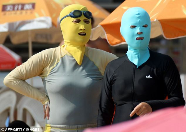 "solsticeretouch:  The Weirdest 'Fashion' Trend To Hit China: Face-Kini The only thing that makes this fashion is the fact that it comes in a variety of designs and you can buy them at swimwear stores. The intent for Face-Kini is protection from the sun.  ""One way to avoid the dangerous rays of the sun is to stay indoors, another is to apply a healthy layer of sun cream and slap on a wide-brimmed hat. If you're in China, however, there is a third option - a 'Face-Kini' complete with a body suit.  The name describes a protective head mask that is being used in Shandong province's East China Sea coast by beach-goers who want to protect their skin from the sun."" ""The clothing was invented around seven years ago and is now under mass production and on sale at swimwear stores along the coast.""     Via Daily Mail   Sexy."