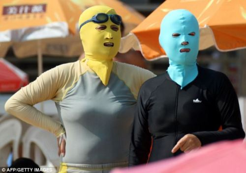 "The Weirdest 'Fashion' Trend To Hit China: Face-Kini The only thing that makes this fashion is the fact that it comes in a variety of designs and you can buy them at swimwear stores. The intent for Face-Kini is protection from the sun.  ""One way to avoid the dangerous rays of the sun is to stay indoors, another is to apply a healthy layer of sun cream and slap on a wide-brimmed hat. If you're in China, however, there is a third option - a 'Face-Kini' complete with a body suit.  The name describes a protective head mask that is being used in Shandong province's East China Sea coast by beach-goers who want to protect their skin from the sun."" ""The clothing was invented around seven years ago and is now under mass production and on sale at swimwear stores along the coast.""     Via Daily Mail"
