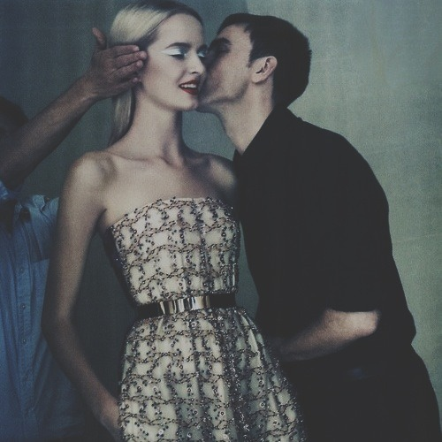 Raf Simons gives a good luck kiss to model Daria Strokous as she prepares to hit the catwalk for his first Dior haute couture show.