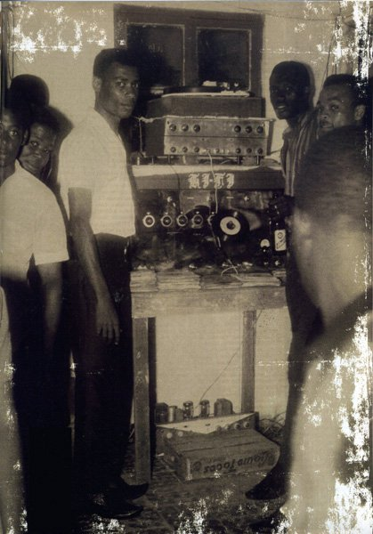 A YOUNG KING TUBBY OPERATING HIS FIRST SOUNDSYSTEM.