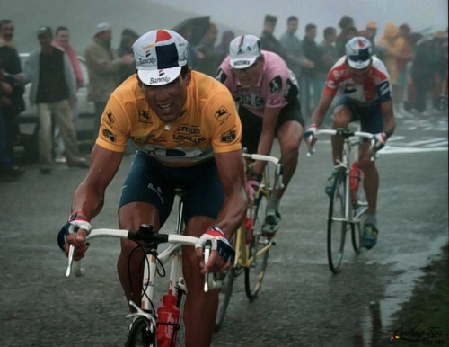 cadenced:  Miguel Indurain, one of cycling's greats and resident of Villava, close to the opening stage of this year's Vuelta a España. Indurain has received a bit of coverage lately following tests published in  International Journal of Sports Physiology and Performance which point to him maintaining much of the fitness of his youth. Photo of Big Mig in the maillot jaune comes from Cycling Tips.