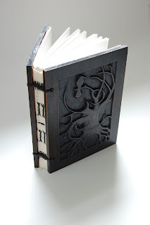 (via Ally Crow) Book cover carving by Allison Crow