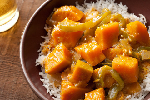 Thai Red Curry with Kabocha Squash INGREDIENTS 1 tablespoon vegetable oil 1 medium yellow onion, medium dice 1 1/2 teaspoons kosher salt, plus more for seasoning 2 medium green bell peppers, seeds and ribs removed and cut into 1/4-inch strips 4 medium garlic cloves, finely chopped 1 tablespoon peeled and finely chopped fresh ginger (from about a 1-1/2-inch piece) 3 tablespoons Thai red curry paste 1 (13- to 14-ounce) can unsweetened regular coconut milk 1/2 cup water 1 tablespoon soy sauce 1 medium kabocha squash (about 2 1/2 pounds), peeled, seeded, and cut into 1-inch cubes 2 teaspoons freshly squeezed lime juice 1/4 cup coarsely chopped fresh cilantro Steamed white rice or steamed brown rice for serving Source & Instructions