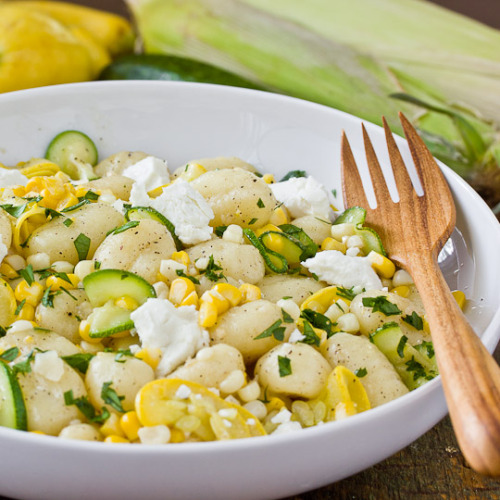 Recipe: Gnocchi with Squash & Sweet CornServes 2 to 41 (16 ounce) package vacuum-sealed gnocchi (from the dried pasta aisle)4 tablespoons unsalted butter, divided1 small zucchini, very thinly sliced1 small yellow squash, very thinly sliced1 cup sweet yellow corn kernels (from about two ears)2 small cloves garlic, peeled and mincedSqueeze of lemon2 ounces soft goat cheese1 tablespoon finely chopped flat leaf parsleySalt and pepper, to tasteSource & Instructions