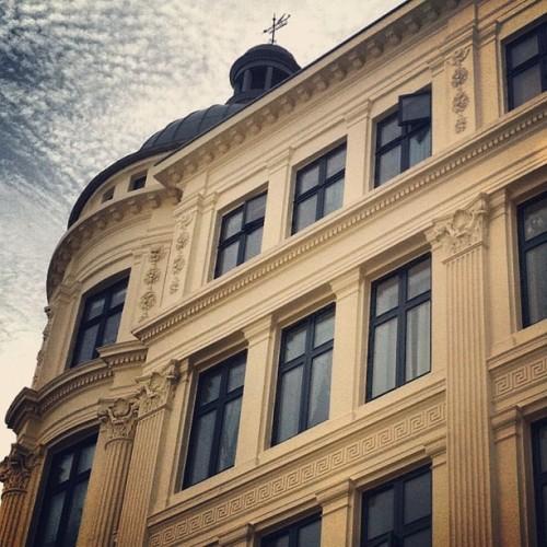 Brilliant shot. caro:  Copenhagen. Old buildings, interesting clouds, etc. (Taken with Instagram)