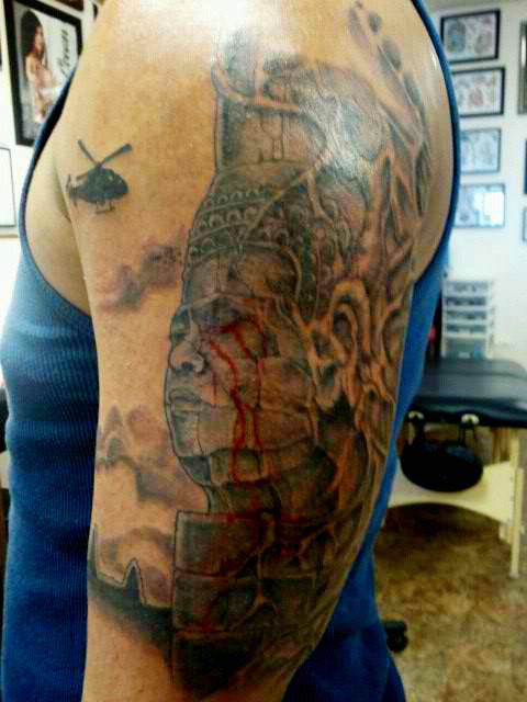 Ghosts of Khmer Rouge Tattoo by shaire productions on Flickr.  Well this is creative. I like the tears effect, it's not the typical Khmer face or Apsara tattoo. Pretty symbolic I guess you could say. :)