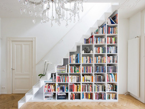 I love when things are beautiful and useful. Just like this staircase! Useful, but beautiful in that it holds all these gorgeously colored books arranged in this triangular bookshelf. Plus, I'm a huge bookworm so this is a great way to arrange all my favorite fiction without taking up too much unnecessary space.