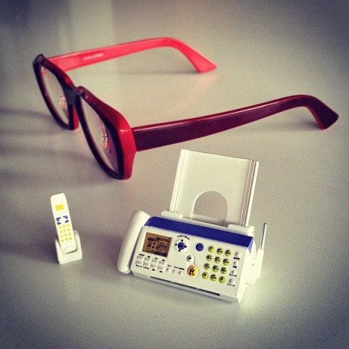 A pair of spectacles and a miniature fax machine.  (Taken with Instagram)