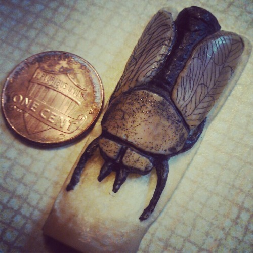 My dad is so awesome. Carved this out of a walrus tooth.