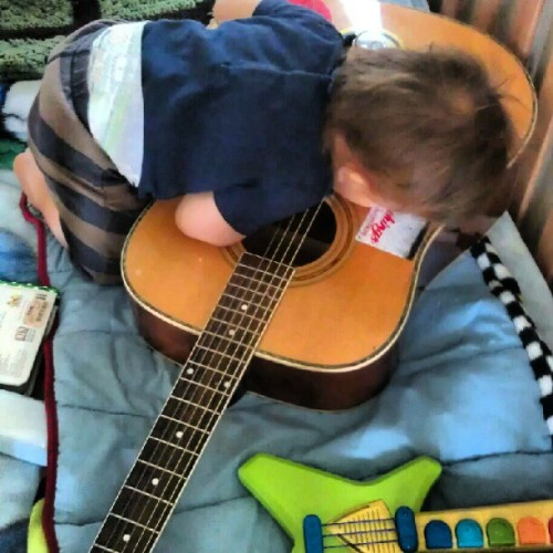 "Guess his ""kiddy"" guitar isn't good enough anymore. #liowolf #littlewolf #guitars #igbabies #silly #kisses #music #howlinwolf #sonhouse #leadbelly #dirtyprettythings #kasabian #thekills #acoustic #movingon (Taken with Instagram)"