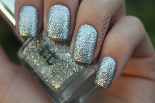A England Merlin on Flickr.I love this polish. Lots of bling!www.coewlesspolish.wordpress.com