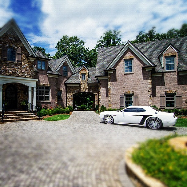 Beautiful entry to a lavish home. #dodgechallenger #car #dodge #house #mansion #luxury #wealthy #driveway #atlanta  (Taken with Instagram)