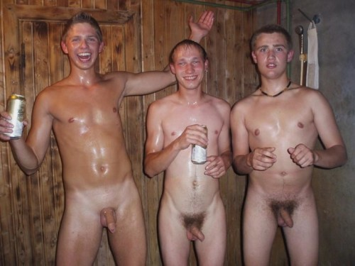 Three nude boys with uncut cocks in the shower, drinking beer.