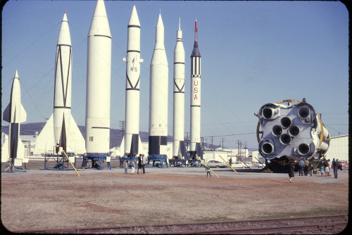 "for-all-mankind:  I absolutely love this photo. It's of the rocket display at the Marshall Space Flight Centre at the Redstone Arsenal, in Huntsville, Alabama, circa early 1960's. The Kodachrome gives the image a retro persona that's only complimented by the vintage, ""small"" scale rockets and missiles of the late 1950's. It's an era long gone in both rocketry and America. Laying down, on the right we have the test article of the S-I stage of the Saturn I. From right to left, we have the Mercury-Redstone, Jupiter-C, Juno II, Jupiter, a rocket I can't seem to remember for the time being, and the Hermes variant of the V-2. For the most part, these rockets are still at MSFC, or at the US Space and Rocket Centre a few miles away. Behind the S-I and car is the Space Orientation Centre - the topic of a post I will hopefully get to soon.  I want to give every one of these a big hug."