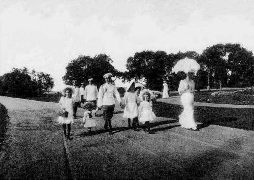 themauveroom:  The Grand Duchesses on a walk with their parents: 1903.   This was actually taken in 1907 :) (Note the little dude next to Tatiana, does it remind anyone of a certain Tsarevitch?) I have a better quality photo somewhere, but I'm afraid I don't know where it is….