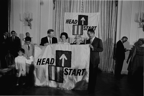 lbjlibrary:  June 30, 1965. Lady Bird attends the ceremony for National Head Start Day. Head Start began as an 8-week summer program as part of LBJ's War on Poverty.  Since then, the program has expanded to include children of all ages and offers services all year.  For more info, check out this page on the program's history at the Office of Head Start's website.  Front Row L-R: Timothy Shriver, Robert Shriver, Danny Kaye, Lady Bird Johnson, Mrs. Lou Maginn (Director of a HeadStart project in East Fairfield, Vermont), Sargent Shriver.