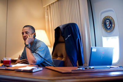 President Barack Obama talks on the phone with NASA's Curiosity Mars rover team aboard Air Force One during a flight to Offutt Air Force Base in Nebraska, August 13th, 2012. (Photo: Pete Souza/The White House)