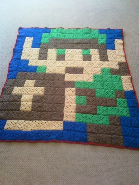 barfingunicorn:  Today I finally finished crocheting the Legend of Zelda blanket for my boyfriend's birthday. It's the biggest project I've ever completed (the only things I've ever knitted or crocheted before are scarves, hats, and tiny bows). It took about 15 days to make it. I think it came out rather awesome. :DEdit: I recently opened an Etsy shop and blankets similar to this are now up for sale. I take requests, in case you want a blanket like this but want a different character on it.