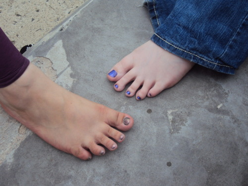 ctbackyardgirls:  Eliza and Vanessa barefoot outside right before it started raining. Vanessa has the blue/purple toenails and Eliza has the metallic toenails.