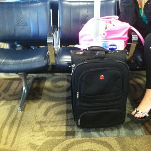 #inside the airport. #secretcreeper this chick looks like she's gonna hurl. #photoadayaug  (Taken with Instagram at Nashville International Airport (BNA))