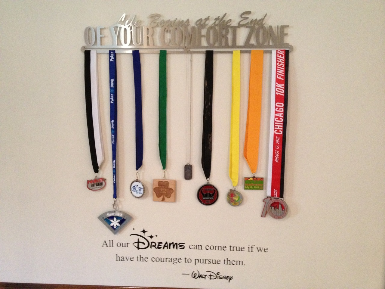 I added this Walt Disney quote to my wall just below my medal hanger and really like how its works together. (This is the quote that will be on the WDW Marathon medal and was a strong influence in casting my fears aside and going for it). I found this Quote as a decal on Amazon.com and ordered it - free shipping, arrived in a few days and was extremely easy to put up.  Really happy with it!