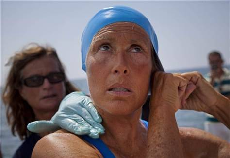 Endurance swimmer Diana Nyad begins Cuba-Florida swim attempt (Photo: Ramon Espinosa  /  AP) HAVANA — American Diana Nyad endured several jellyfish stings as the 62-year-old endurance athlete sought to become the first person to swim unaided from Cuba to Florida without a wetsuit or a shark cage. A team member posted on Nyad's Twitter account that the American was steadily stroking onward early Sunday despite jellyfish stings to the lips, feet and legs. Her goal: to become the first person to set a record 103-mile (166-kilometer) unaided crossing of the Florida Straits. Read the complete story.