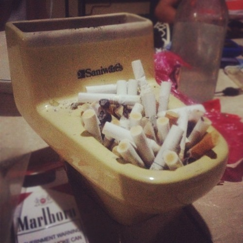 Dump your sh*t elsewhere. This one's #full! :)) #cigarette #cigbutts #toiletbowl #ashtray #party #innovation #instagram  (Taken with Instagram)