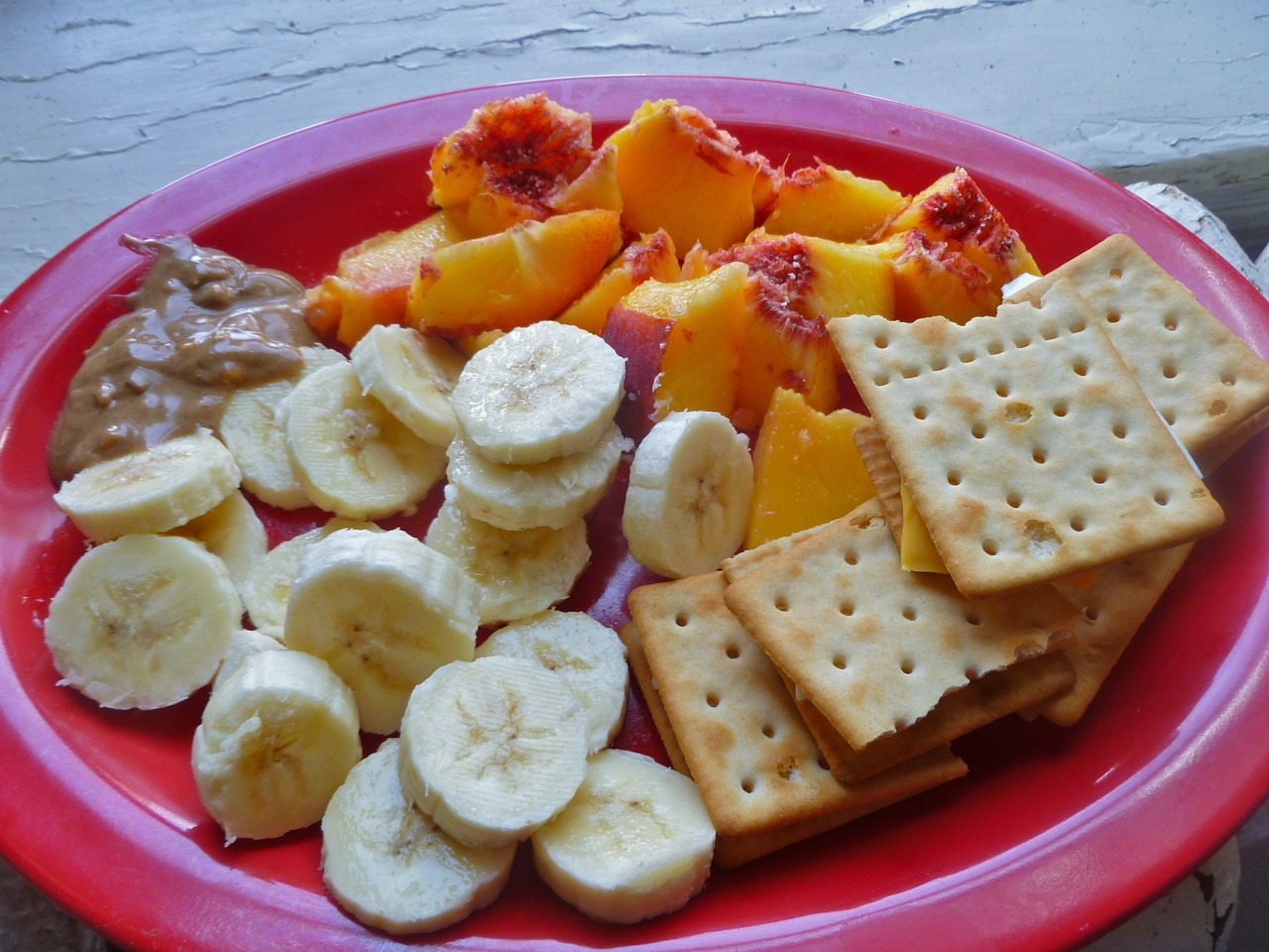 morning meals: fresh fruit with almond butter and Schar Dedicated Gluten-Free Table Crackers