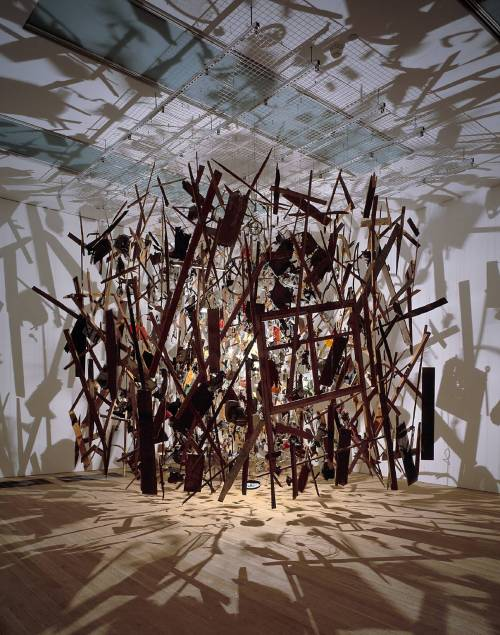 slowartday:  Cornelia Parker: Cold Dark Matter: An Exploded View, 1991 The visual cacophony that Parker creates in this mixed media installation is stunning; we particularly like her use of light and shadow to expand the piece's boundaries past their physical edges. If you stumbled across this work in a museum, how long do you think you'd spend looking at it?