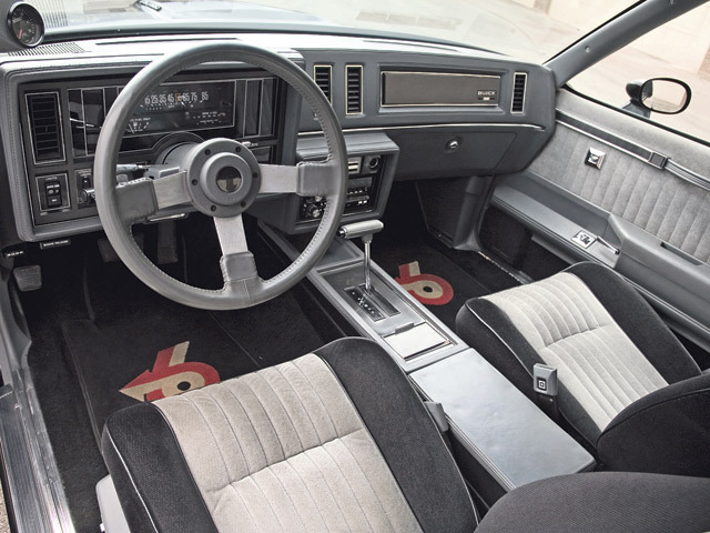 1984 Buick Grand National Interior.   The previous Grand National posting is actually a 1987 GNX, a Grand National modified by McLaren, which came with round Stewart-Warner gauges.  As much as I love the Grand National, the original dash is a hideous creation and the GNX layout was a vast improvement, giving a serious muscle car a serious interior.