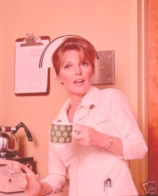 georgshadow:  queue post one of my favorites of Julie London as Dixie McCall EVER. It's not just the strange pink filter, it's that such a beautiful, lovely woman even looks cute sometimes too.