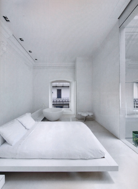 cjwho:  The White House - Monza, Italy  This spectacular home in Monza, just outside of Milan, Italy definitely fits the bill. This home actually started out in the early 1900s as a burlesque theatre, later became a bank before being abandoned and left dilapidated before the current owners found it and undertook a massive transformation. Valeria Presezzi and her family worked with renowned Italian architect Piero Lissoni to create a serene and tranquil home around the building's original historic shell.