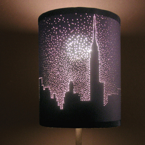 DIY City Skyline Pierced Lampshade Video Tutorial from ThreadBanger here. First seen at Guapizimo here. *If you have questions about the weight of paper there are lots of tutorials around on how to make a paper lampshade.