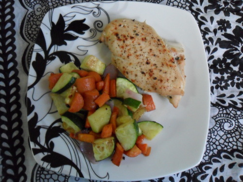 crazybydesigns:  Suppertime! I'm going to start using (this) smaller plate, because it makes portion sizes much-o easy-o. It has: chicken brushed with olive oil and sprinkled with ground black pepper, cayenne pepper and garlic powder. And veggies! Roasted zucchini, carrots, red onion and wee bit of potato all tossed in olive oil and sprinkled with ground black pepper and garlic salt. Easy peasy lemon squeezy. Also, it ment with the Boo Seal of Approval. Gluten- free and healthy. Yay!
