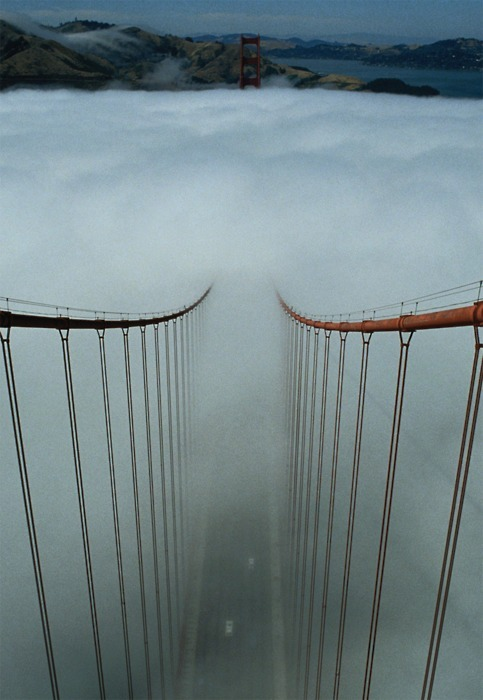blua:  Bay Bridge in SF, California under heavy fog.
