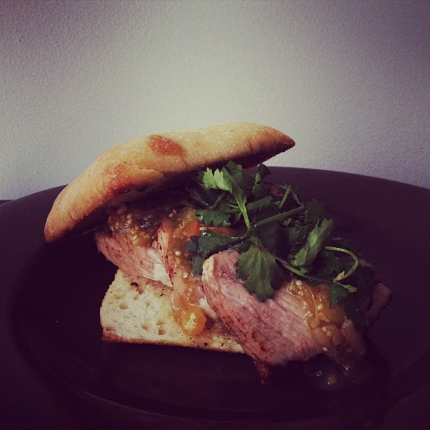 Dry rubbed pork loin sandwich. Peach-tomatillo, fresh cilantro. (Taken with Instagram at The 503 Kitchen)