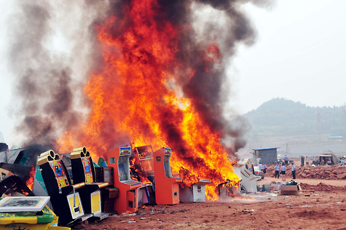 Local policemen recently destroyed some 1,000 confiscated gambling machines in Shunqing District of Nanchong City, China