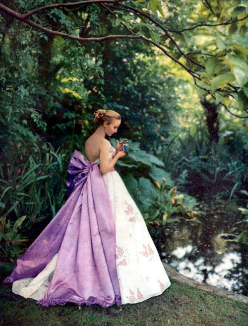 Model wearing an evening gown, photographed by Cecil Beaton, 1958.