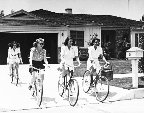 Rita Hayworth leaving her house with friends, 1940. Photo by Peter Stackpole