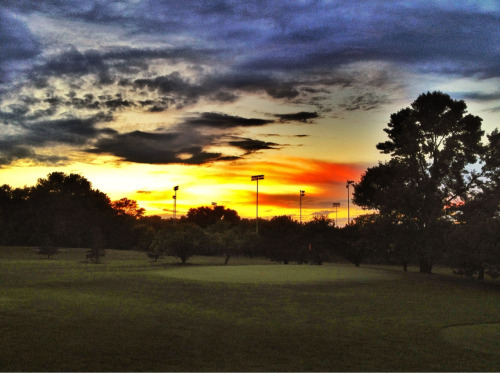 Fiery sky over the 9th green.