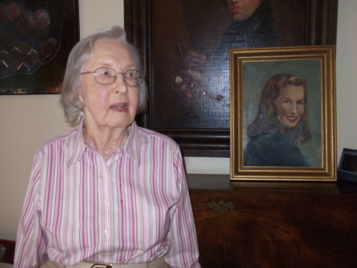 This is Golden Age artist Fran Hopper, standing next to a portrait of herself she painted in the 1940s, around the time she was working for the publisher Fiction House. Trina Robbins just e-mailed this to me—as rediscovering Ms. Hopper alive and well was joint effort between us!—and I still can't believe how fortunate we are to have a chance to preserve one more small corner of women's comics history before her memories were lost to us like so many others. Fiction House comics are all in the public domain, so it's not too hard to find Ms. Hopper's work online if you dig around, but here are two stories about adventure heroines Mysta of the Moon and Gale Allen (along with a Lily Renée story) from the Golden Age Comic Book Stories blog.  It's fun stuff, and Ms. Hopper's art is capable and strong.
