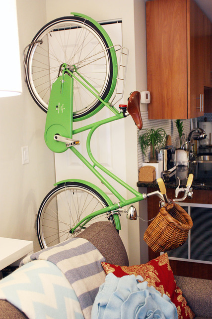 green bicycle on the living room (via apartment therapy)