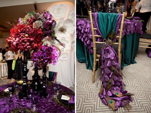 purple table setting with peacock feathers