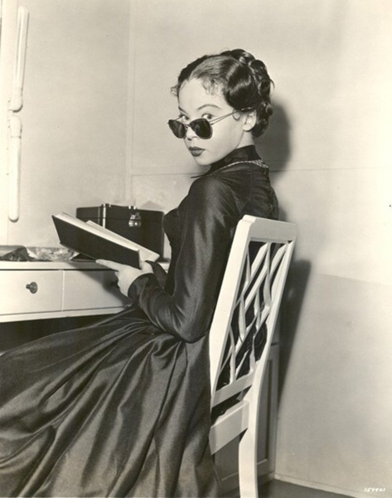 Leslie Caron reads. vintage-retro:  Leslie Caron reading in her dressing room during the filming of 'The Man with a Cloak', 1951.