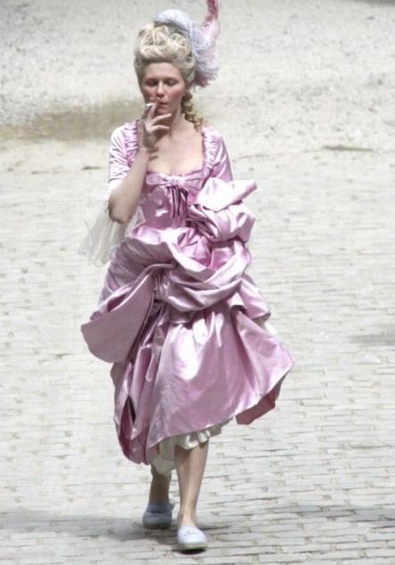 suicideblonde:  Kirsten Dunst during the filming of Marie Antoinette