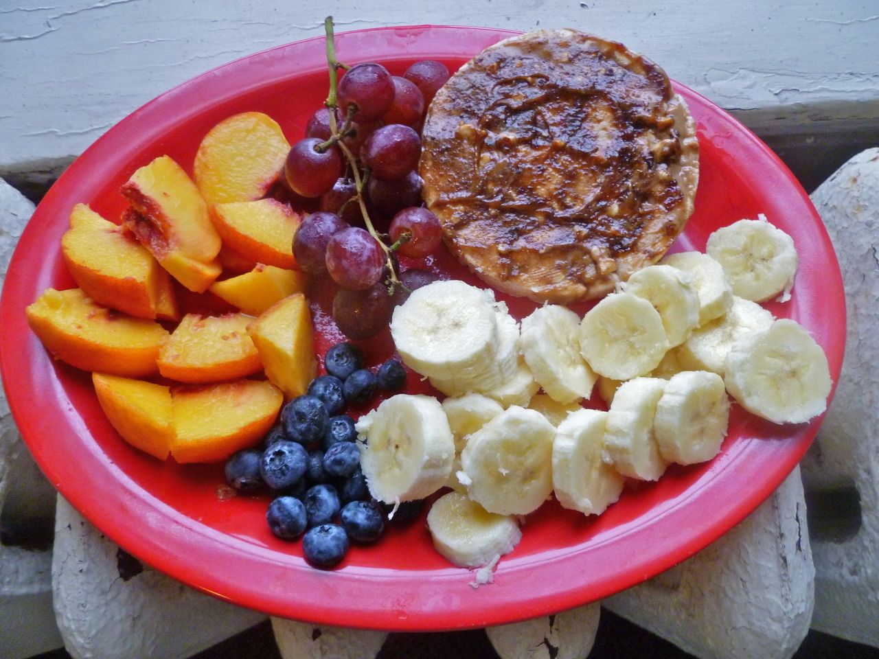 morning meals: fruit and a rice cake with almond butter and fig butter spread