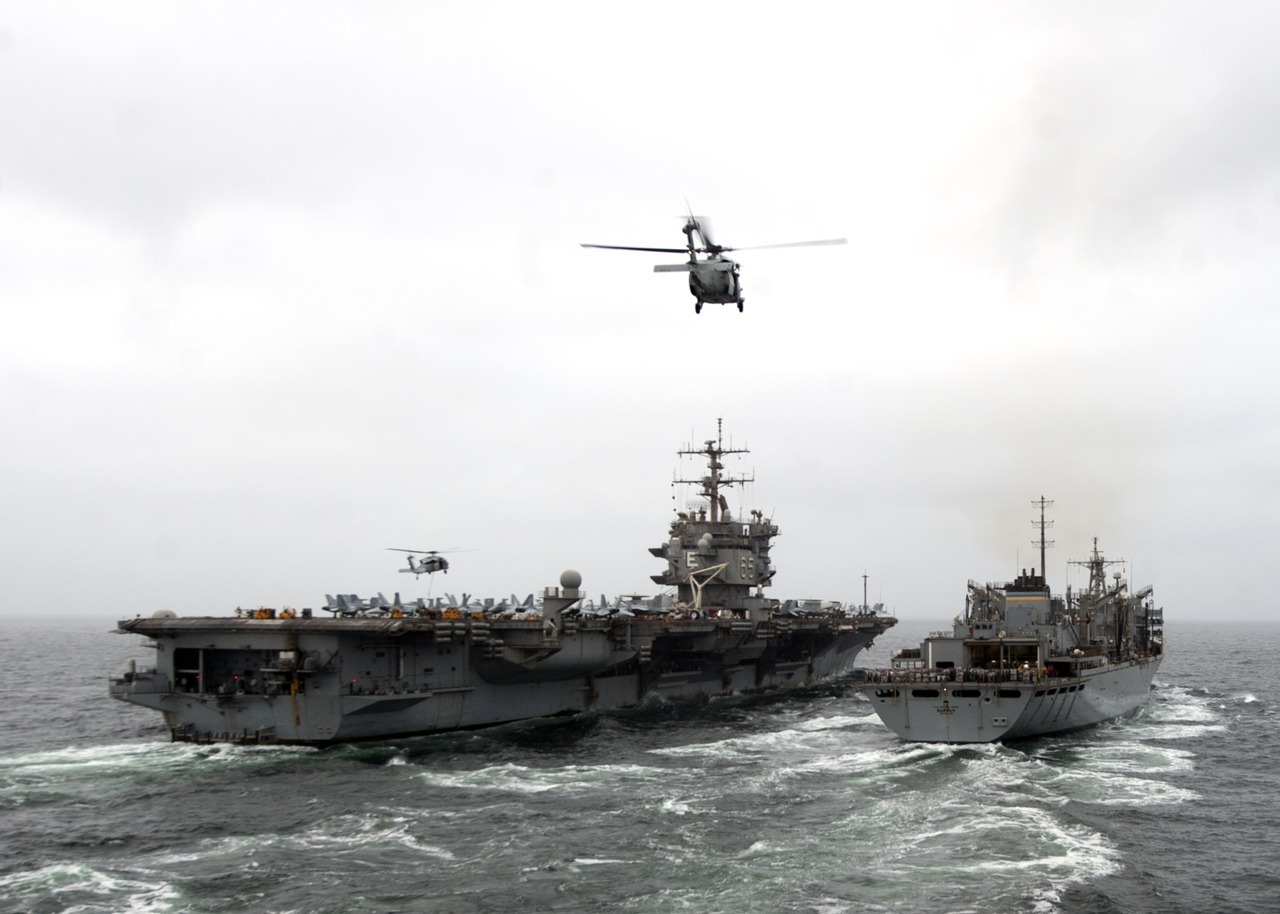 fuckyeahusnavy:  The aircraft carrier USS Enterprise (CVN 65), left, and the Military Sealift Command fast combat support ship USNS Supply (T-AOE 6) conduct a replenishment at sea. Enterprise is deployed to the U.S. 5th Fleet area of responsibility conducting maritime security operations, theater security cooperation efforts and support missions for Operation Enduring Freedom. Supply is assigned to Commander, Task Force (CTF) 53 providing fuel and supplies to U.S. Navy and coalition ships in the same region.