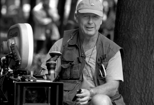 "'Top Gun' director Tony Scott dies after jumping from L.A. bridge British film director Tony Scott, known for such Hollywood blockbusters as 'Top Gun,' 'Days of Thunder,' 'Beverly Hills Cop II' and 'The Taking of Pelham 123,' jumped to his death Sunday from the Vincent Thomas Bridge in Los Angeles, according to L.A. County officials. Scott, 68, climbed a fence on the south side of the bridge's apex and leapt off ""without hesitation"" around 12:30 p.m., according to the Coroner's Department and port police. [[MORE]] A suicide note was found inside Scott's black Toyota Prius, which was parked on one of the eastbound lanes of the bridge, said U.S. Coast Guard Lt. Jennifer Osburn. Scott directed Tom Cruise in 'Top Gun,' — one of the highest-grossing films of 1986 — and worked with the actor again four years later on the hit 'Days of Thunder' —which also featured his third and current wife, actress Donna Scott. The couple have twin boys. Known for his trademark red baseball cap, Scott also directed 'Beverly Hills Cop II,' starring Eddie Murphy, 'Enemy of the State,' starring Will Smith and Gene Hackman, and 'The Taking of Pelham 123,' starring Denzel Washington and John Travolta. Authorities used sonar equipment to track Scott in the port's murky waters and his body was recovered by a dive team around 4:30 p.m., Osburn said. Scott's body was taken to a near-by dock, in Wilmington, where it was turned over to the county coroner. Erected in 1963, the 6,060-foot bridge links San Pedro with Terminal Island and rises 185 feet at its highest point above the Main Channel of Los Angeles Harbor. Many have taken their lives by jumping from the span."