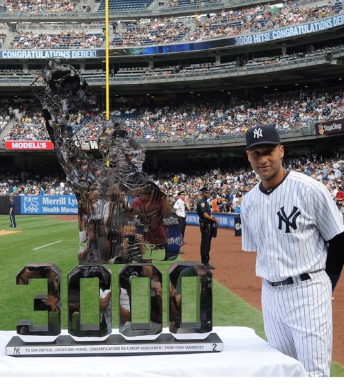 Derek Jeter posing awkwardly lol next to his 3000 hit statue during the awards ceremony last year. I was at the game that day..